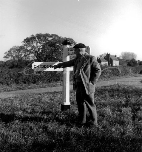 Pablo Picasso by the signpost to Chiddingly, East Sussex (1952) by| Lee Miller