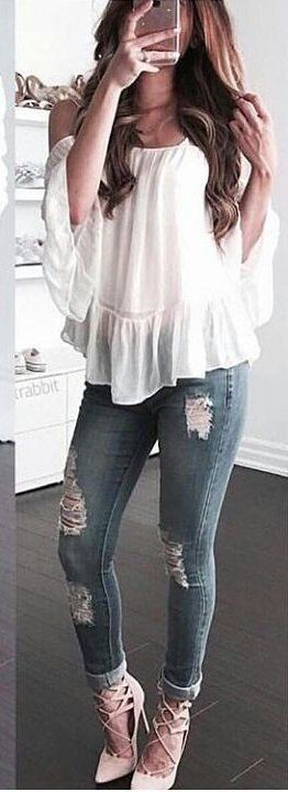 #spring #outfits woman in white off-shoulder top and blue jeans taking selfie during daytime. Pic by @fashiontopsite #dressescasualspring