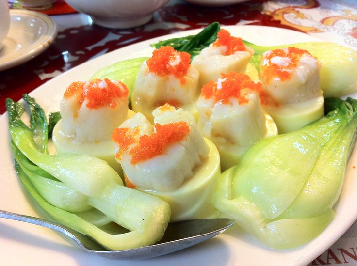 Exquisite! Tender scallops steamed atop medallions of silky tofu! At New Canton Restaurant in Qualicum Beach, BC on Vancouver Island.