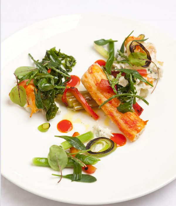 Alaska king crab, leeks, red pepper and cardamom dressing and sea vegetable salad - This king crab and leek recipe from Dave Watts produces a feast for the senses - meaty Alaska king crab is paired with burnt leek and sea vegetables, with a dressing of red pepper and cardamom. King crab is usually purchased in clusters of legs and body, which makes this beast of a crustacean much easier to manage.