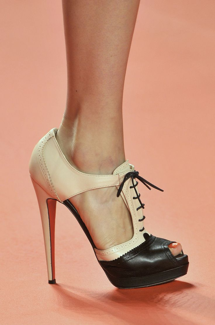 Christian Louboutin hits another one out of the ballpark - 50's inspired beauty in neutral and black (open toe)