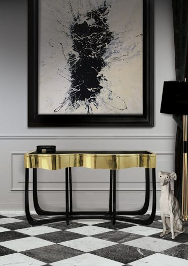 A trendy hall with a black and gold console table with drawers and a matching black and gold floor lamp byBocadoLobo. #homedecor #interiordesign #brassaccents See more: http://www.brabbu.com/en/all-products.php