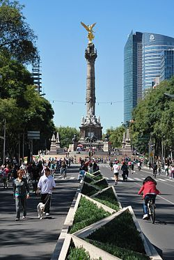 """El Ángel de la Independencia (""""The Angel of Independence""""), most commonly known by the shortened name El Ángel and officially known as Monumento a la Independencia, is a victory column located on a roundabout over Paseo de la Reforma in downtown Mexico City. El Ángel was built to commemorate the centennial of the beginning of Mexico's War of Independence, celebrated in 1810. In later years it was made into a mausoleum for the most important heroes of that war."""