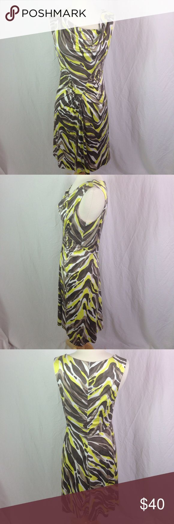Trina Turk Ruched Silk Jersey Knit Dress Zebra Trina Turk Ruched Silk Jersey Knit Dress Zebra Stripe, but also a camouflage of brown, taupe and bright yellow. Pretty ruching on the front makes it very flattering! Please ask questions before you buy, thanks! Trina Turk Dresses Midi
