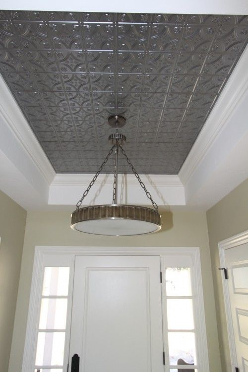 Decorate with tin tiles. Fill in the ceiling of your tray with tin for a dramatic look. This is a great way to bring in an element that really makes a statement.