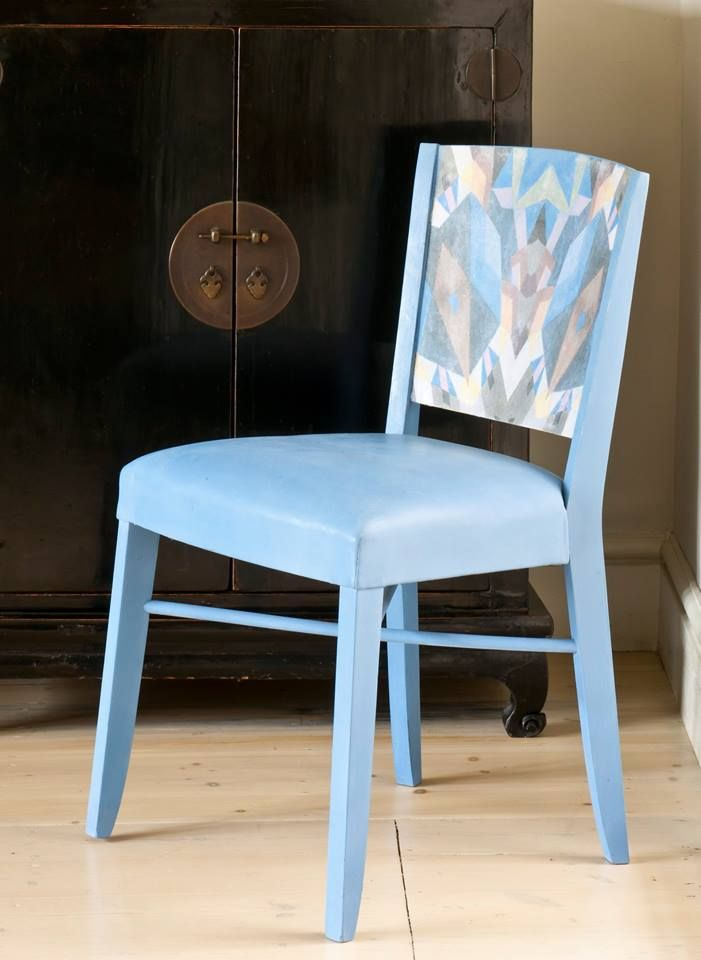 Modern chair with mixed color and pattern. Annie Sloan transformed this piece with a printed abstract image transferred onto the back with Annie Sloan Image Medium. Chalk Paint® in Greek Blue and Clear Chalk Paint® wax on the leatherette seating and frame complete the look. Over time, the seat softens and cracks, just like real leather. This beautiful project is featured in the book, 'Annie Sloan Paints Everything'.