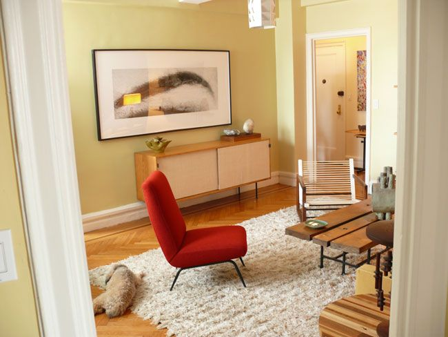 A white shag rug provides a cozy backdrop for the mid century modern  furniture in this living room  A red chair balances the cool yellow green  of the wall. 32 best Mid Century Modern images on Pinterest   Shag rugs  White