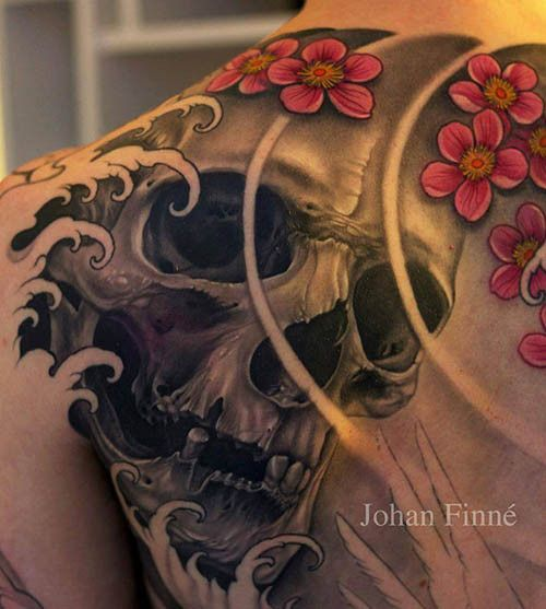 This skull being overtaken by waves was tattooed by the talented Johan Finne.