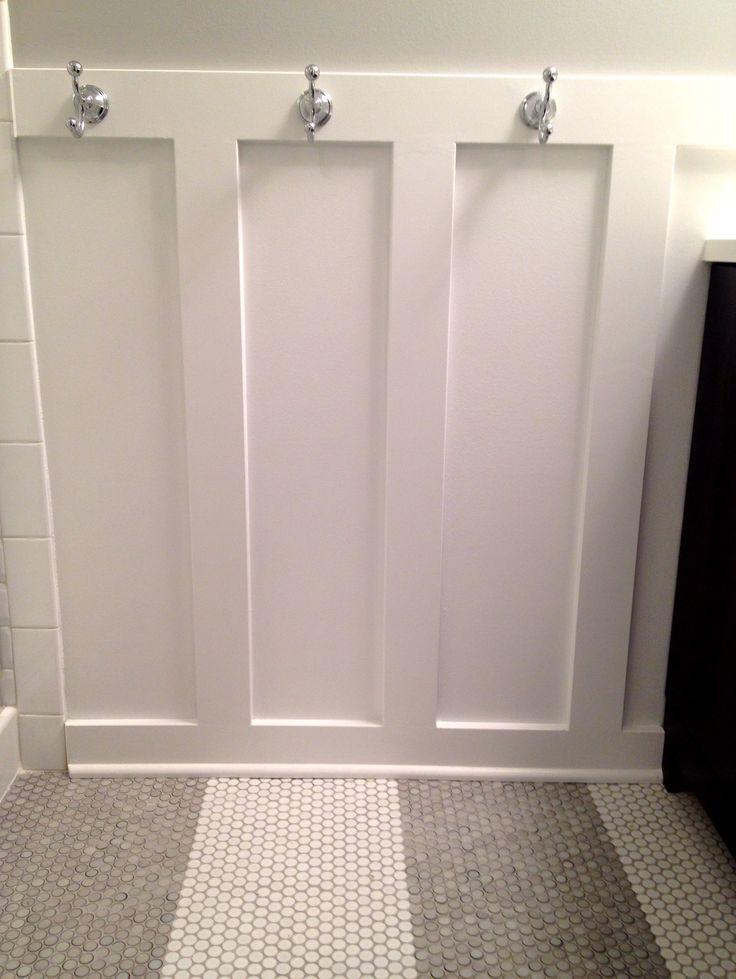 Traditional with a modern twist- penny tile in stripe pattern! Board and batten + hooks