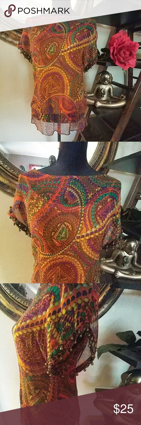 Colorful unique boho top! Very unique top! Very colorful top with two layered sheer material. Built in burnt Orange cami top that is removeable make top not sheer. Cute antique gold colored beads to sleeves, all intact. In excellent condition! Chelsea & Theodore is brand. Tops Blouses
