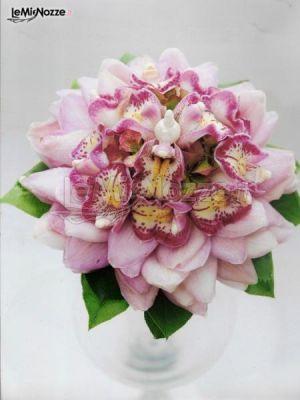 http://www.lemienozze.it/gallerie/foto-bouquet-sposa/img34243.html Bouquet di orchidee rosa che formano un unico fiore