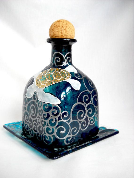 Big Moana & the Sea Turtles art on glass. A reclaimed hand designed Patron bottle painted in deep turquoise blue with faux pewter scrolled waves on the bottle surround featuring one large sea turtle a                                                                                                                                                                                 More