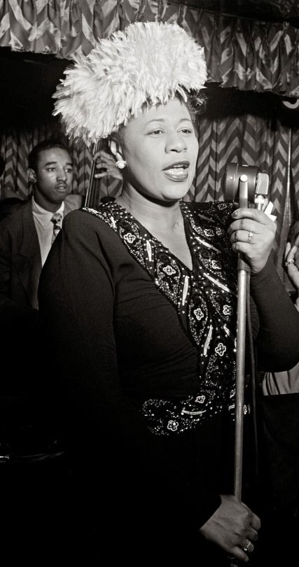 Ella Fitzgerald singing at the Downbeat Club in New York City, 1947. Jazz legend, Milt Jackson in the background to the left. Photo by William P. Gottlieb.