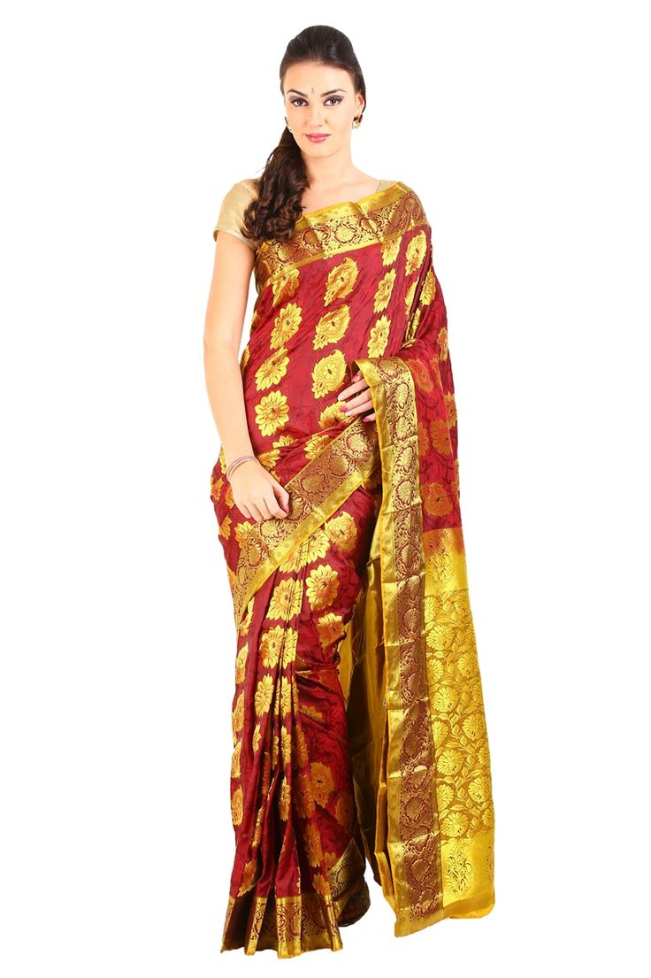 We added a unique blend of traditional Shari's to make you symbolize the perfect depiction of artistry in modern era.  Choose this Kanjivaram Silk designed gorgeously with full body flame red in color with handwoven works in golden color. Pallu and border of the shari is crafted with wide contrast floral zari border.