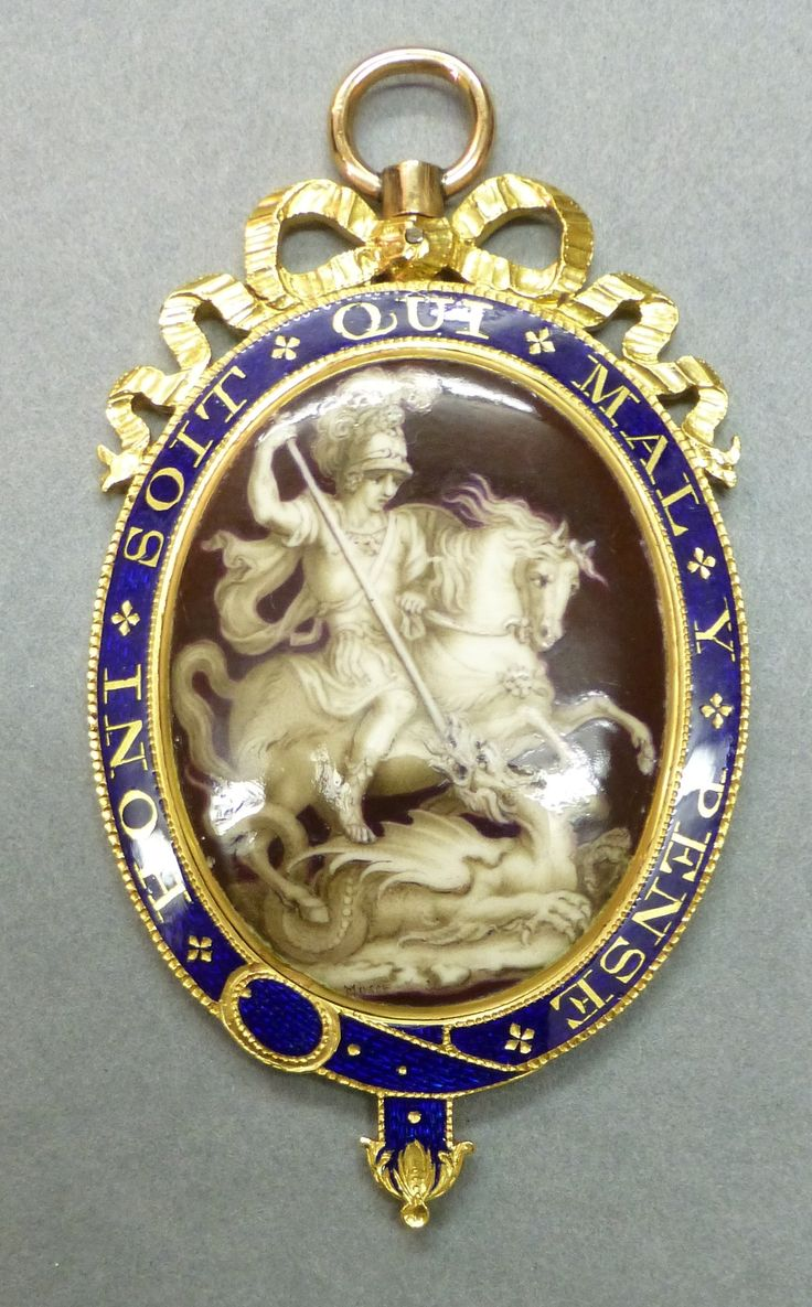 Badge of The Order of the Garter, centre enamelled en grisaille with St. George and the dragon, c.1780-85, 66 x 36mm.