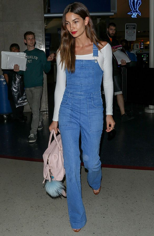 Lily Aldridge in overalls with a white, off-the-shoulder long sleeve top