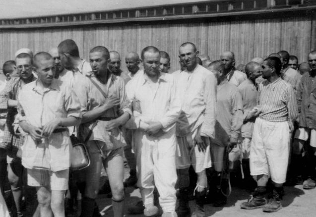 148 of 192 Birkenau, Poland, Men who passed the selection and camp registration process, waiting to be taken to their barracks, 05/1944. 5272076483630414179.JPG