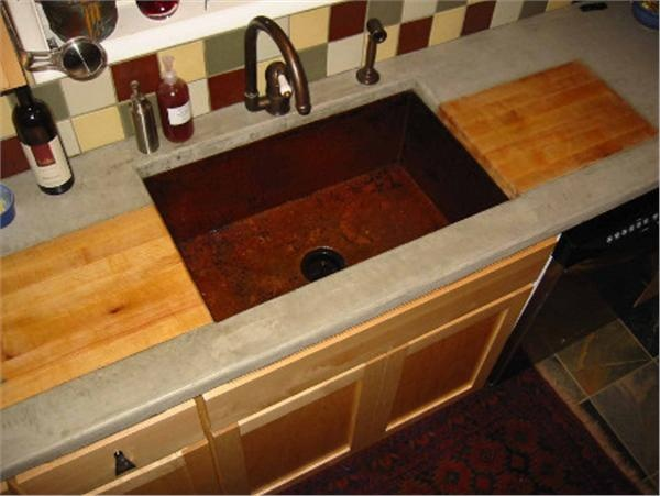 Copper Kitchen Sink-  The butcher block along the sides?
