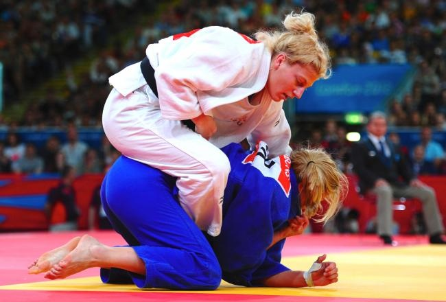 Kayla Harrison Captures 1st-Ever USA Olympic Women's Judo Gold Medal: Forms of judo have been contested in the Summer Olympics since 1964, and women have competed since 1992, but no American had ever managed to capture a gold medal. That is no longer the case, however, as Kayla Harrison defeated Great Britain's Gemma Gibbons 2-0 in the women's half heavyweight final to take gold on Thursday. Harrison won gold at the World Championships in 2010, so she was certainly among the...