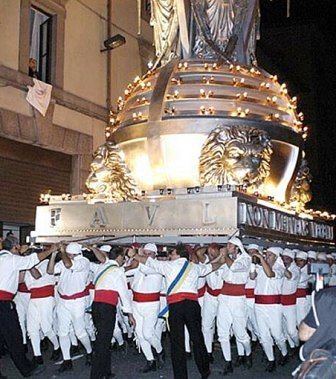 """an ancient procession in honor of Santa Rosa, was held in Viterbo (Italy) every year on September 3. The """"machin"""" is transported from one hundred """"facchini"""""""