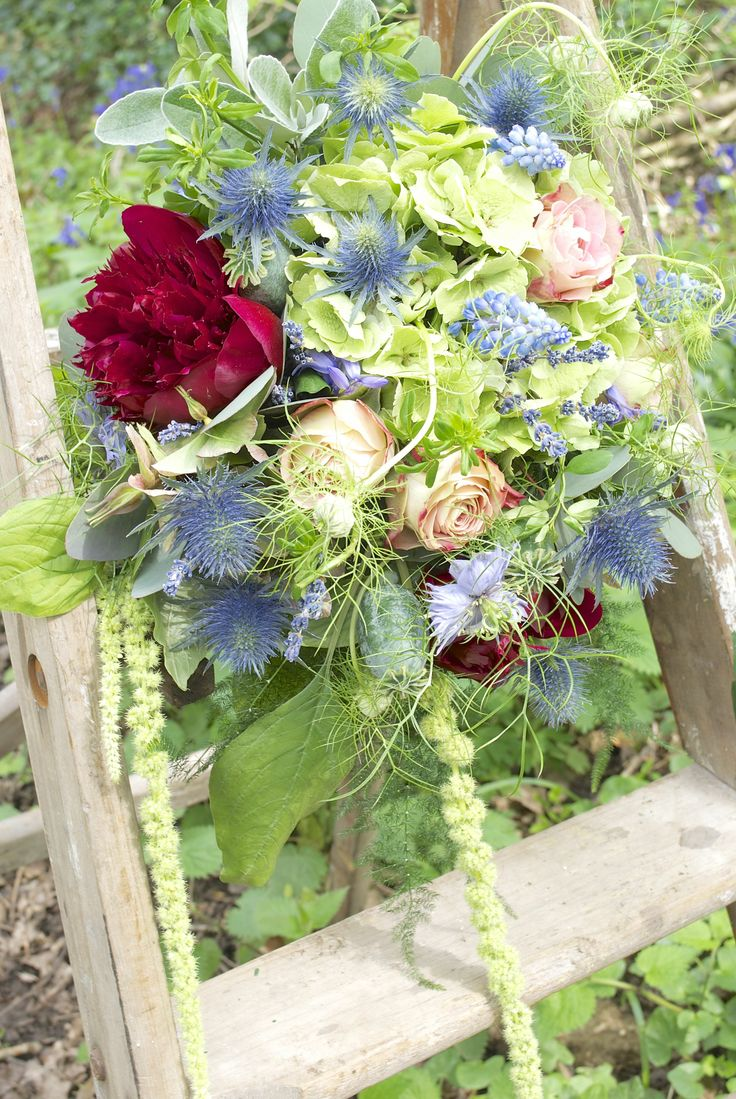 Bridal bouquet of green Hydrangea, Upper Secret Roses, Green Amaranths, Muscari, Euringium, dried Lavender, and red Peonies, designed and created by www.hannahberryflowers.co.uk