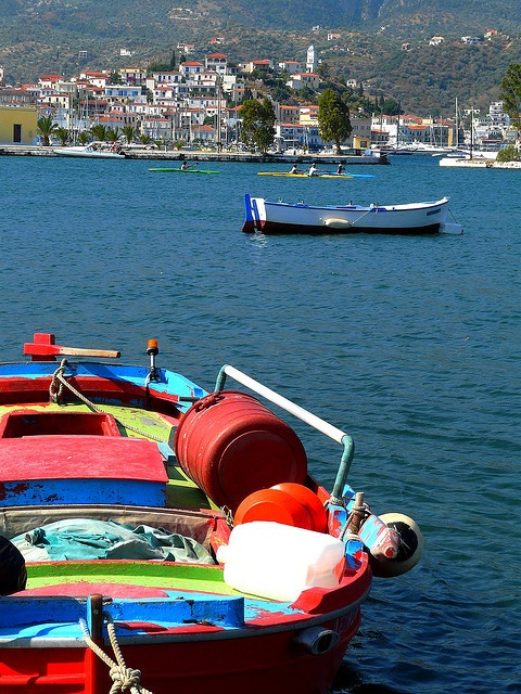 Colorful fishing boat and scenery. Poros island, Saronic, Greece
