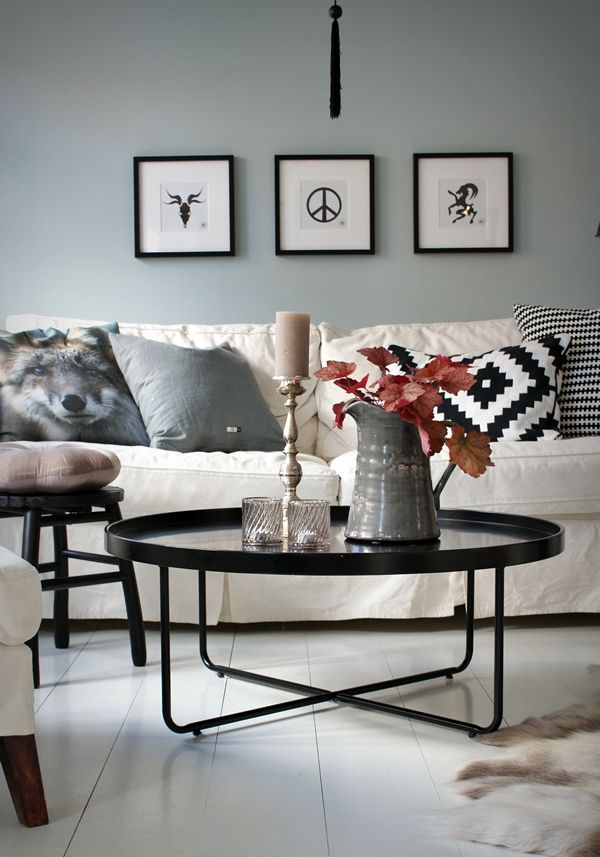 Loving the cool gray wall and that coffee table that looks like a giant tray