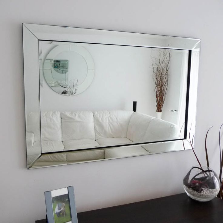 As Seen On 60 Minute Makeover! This beautiful glass framed mirror is the ultimate in modern stye.A very stylish and elegant mirror that is finished to a high standard. Thiswonderful glass framed mirror would look equally at home in either a contemporary or more traditional home décor. The glass framed mirror