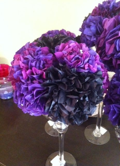 Tissue paper centerpieces on martini glasses to make long runner. Candles between glasses