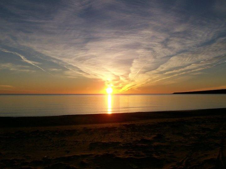 The sunset at Cheticamp Beach in Cape Breton.