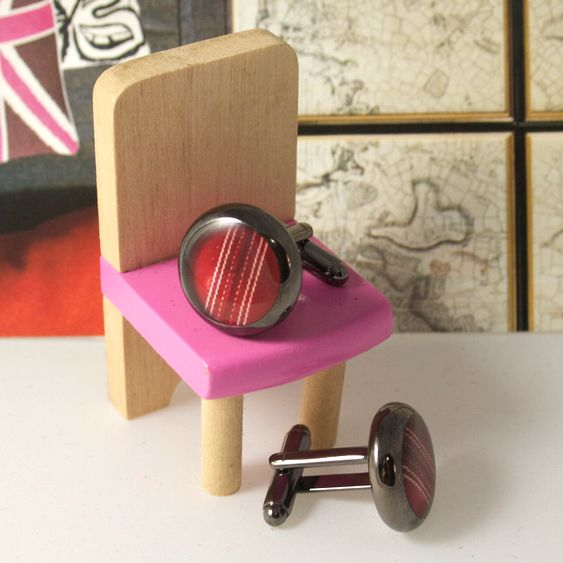 Gunmetal cricket ball cufflinks for a cricket loving chap