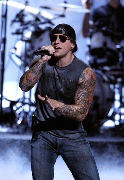 M. Shadows of Avenged Sevenfold, no wonder I love their music so much, I can't say no to those muscular tattooed arms.