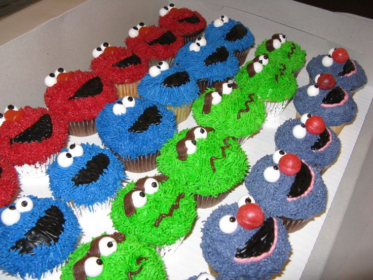 Sesame Street Cupcakes - These were very simple to make.  Use the Wilton grass tip for all piping work.  Eyes are white gumballs.  Grover's nose are dum dum lollipops.
