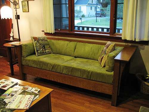 Mission style furniture like this sofa gained popularity in the America around the turn of the 20th century and contrasts to the more ornate furniture styles of the Victorian era.