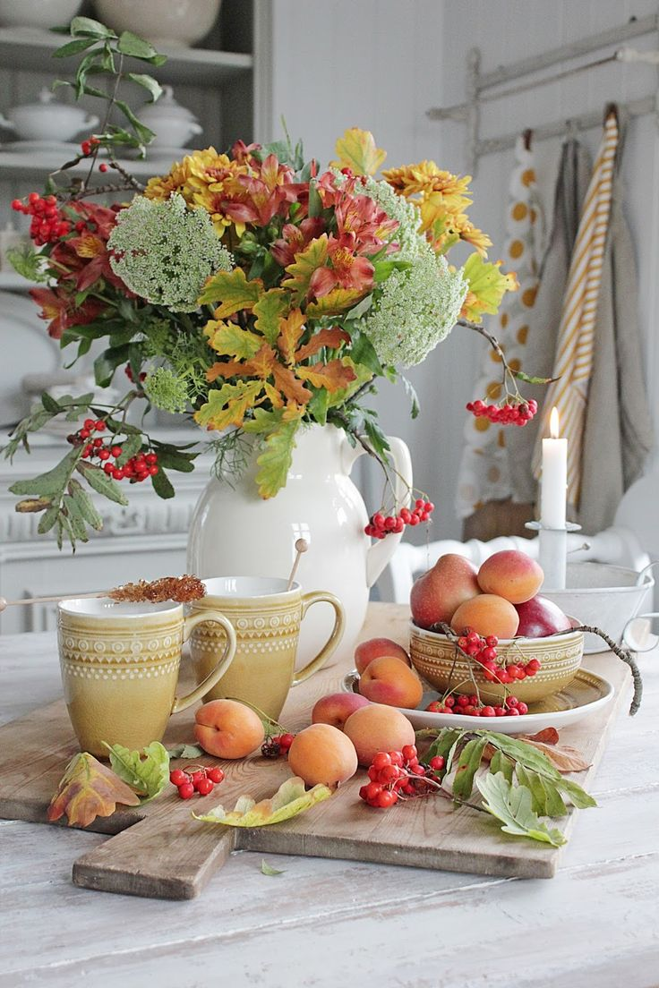 early fall decorating with flowers and peaches and coffee mugs