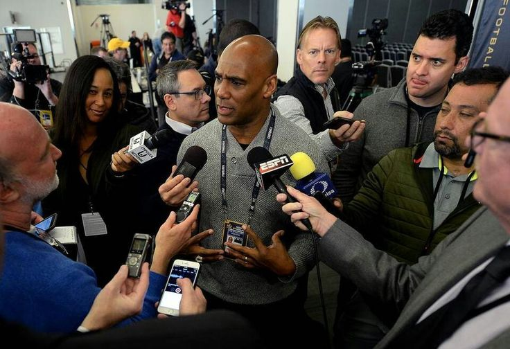 Carolina Panthers radio broadcast analyst Eugene Robinson, center, speaks with reporter's following a press conference on Tuesday, February 2, 2016 at the San Jose Convention Center in San Jose, CA. Robinson spoke to the team before they left Charlotte for San Francisco about the incident where he was arrested the night before Super Bowl XXXIII for soliciting prostitution in Miami.