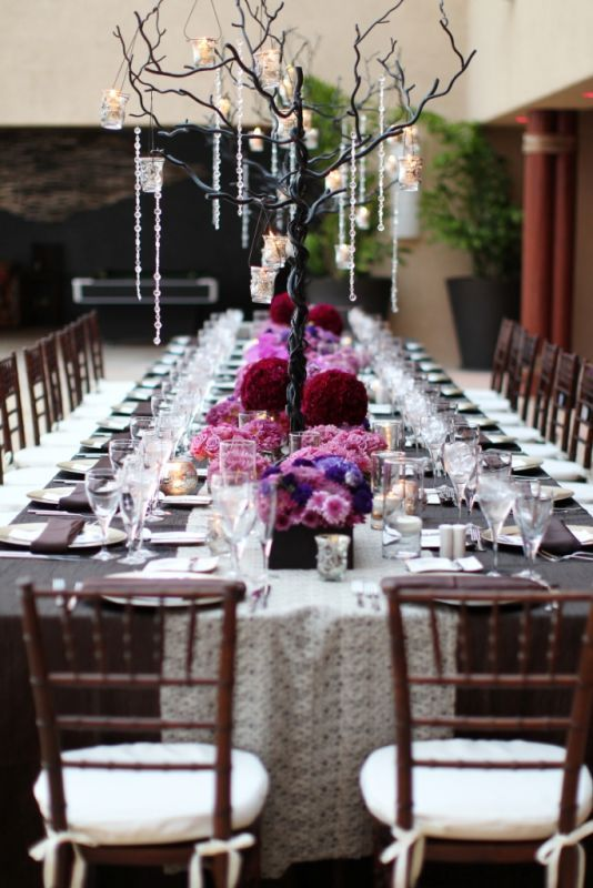 iron trees centerpieces, purple, fuschia, pink flowers, wedding table setting