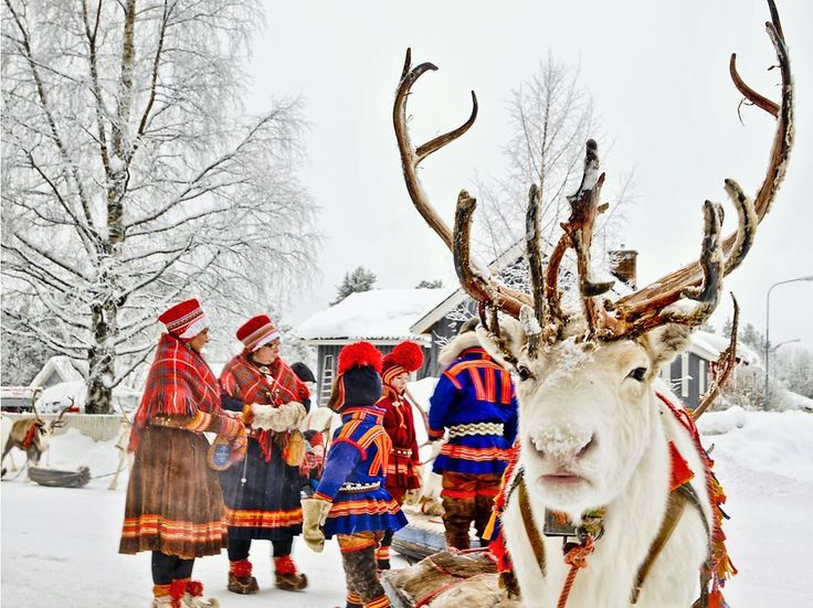 Sami Reindeer Herders, Sweden:  Decked in traditional clothing, Sami reindeer herders prepare to leave for a winter fair in Sweden. The Sami's homeland spreads across northern Norway, Sweden, Finland, and Russia. Herders follow the migrations of the reindeer as they move from winter grazing grounds to cooler areas during the summer months. Photograph by Lola Akinmade Akerstrom, January 25, 2014