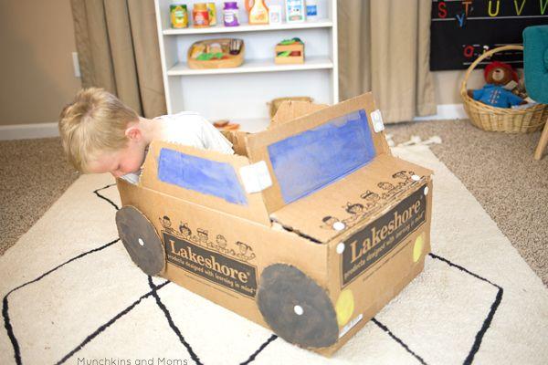 The Easiest Diy Cardboard Box Car Munchkins And Moms Diy Cardboard Cardboard Box Car Cardboard Box