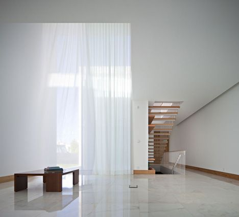 Extra large window inside the House in Moreira by Phyd Arquitectura. Large windows add a feeling of openness.