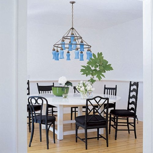 Beautiful splash of color in black and white dining area