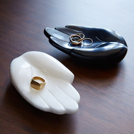 A helping hand. Inspired by an object found in India, this hand dish is just the right size to hold coins or rings.