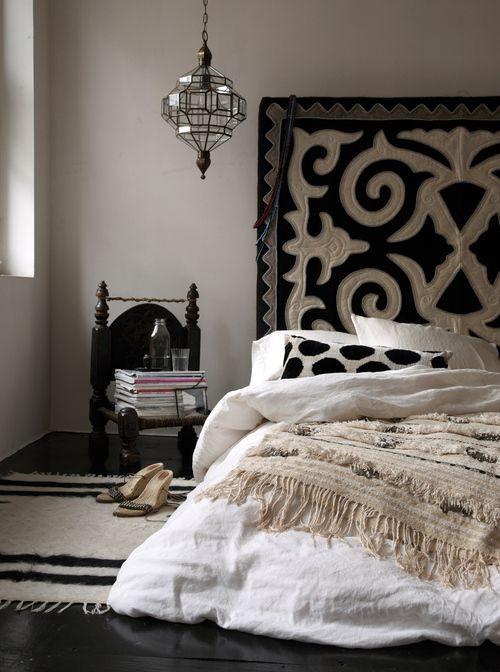 Classy and elegant bedroom design. The neutral colour scheme with the bold black create a calming and elegant colour scheme.