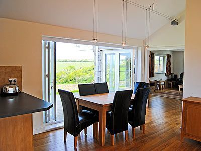 #CornwallHolidayCottage #Crantock  This contemporary, detached holiday home sits in a quiet lane overlooking a quaint meadow across to the sea and small coastal village of Crantock. The coastal path runs close to the house; Newquay and Watergate Bay are nearby.  http://www.chooseacottage.co.uk/cwa/curlews-tlw