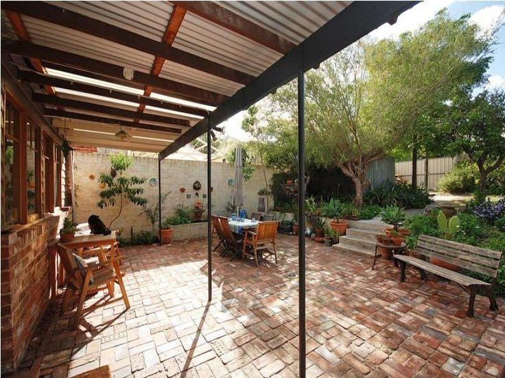 Paved patio split level pergola house no mow for Split level patio