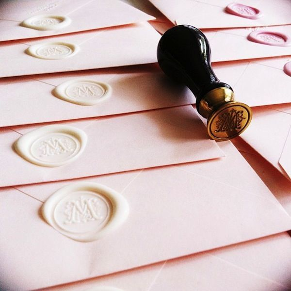 Another Great Example by stripesandsequins.com of our Scroll Initial Wax Seal being use on some elegant and delicate invitations. The white flexible wax adds a nice finishing touch to an already soft look.  These seals are compatible with all of our waxes and the flexible wax is available as self adhesive stickers to make quick work of any bulk sealing project.   http://www.nostalgicimpressions.com/Adhesive_Wax_Seals_Single_Initials_s/200.htm