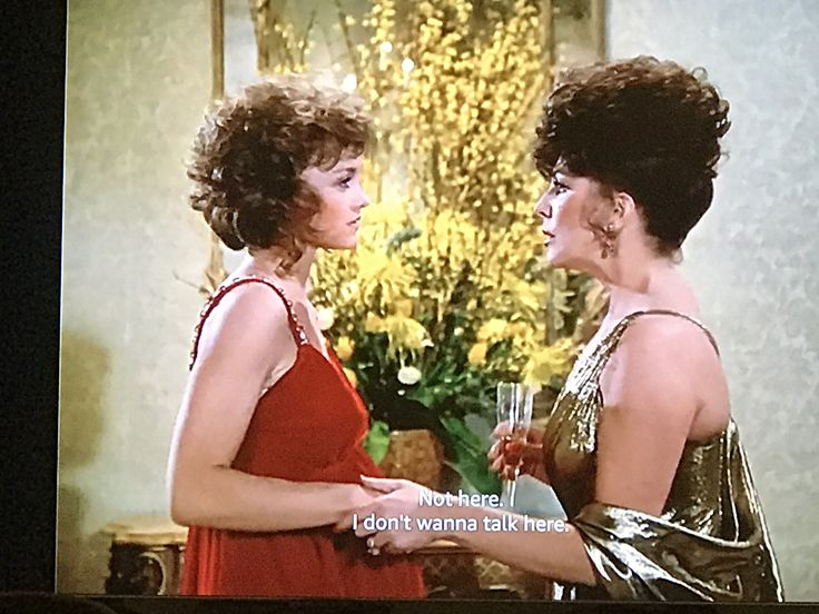 Joan Collins's dress at this party is so extra.