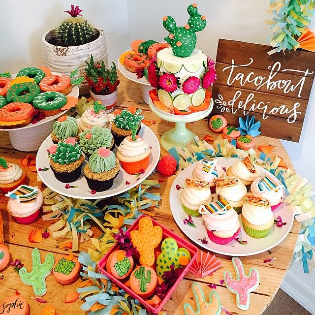 "So we celebrated a double bday party last night for my babe and her best, and let's just say the dessert table was almost too pretty to eat! Yes those are tacos on the cupcakes & Mexican blankets & cactus donuts & cactus shaped macaroons & cactus cupcakes, oh and those cake toppers..  can't wait to share more! @sweetnsaucyshop blew it out of the water for this fiesta! Adorable ""taco'bout delicious"" sign by @poppyjackshop too good!"