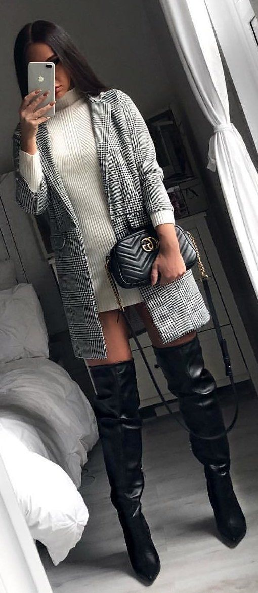 Amateur selfie in sweater minidress and thigh boots