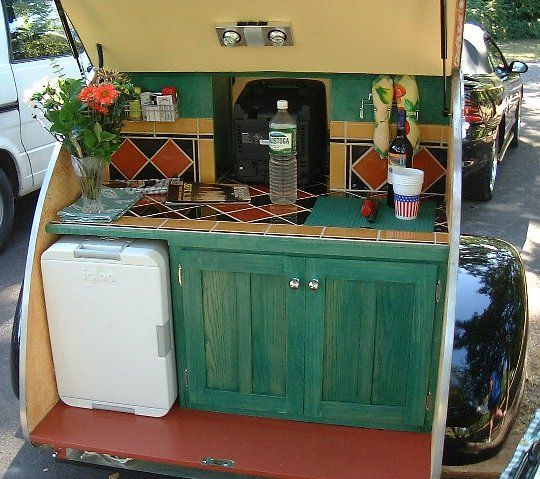 The back end of a teardrop camping trailer. I want one of these!!
